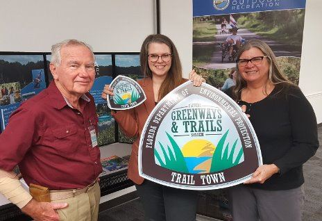 Kelly Carson of Winter Garden (center) with Brian Smith on left (vice chair of FL Greenways and Trai