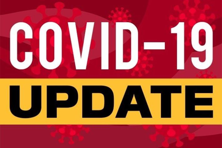 Covid 19 Update text with red background